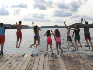 Tawingo College students swim in Lake Vernon.
